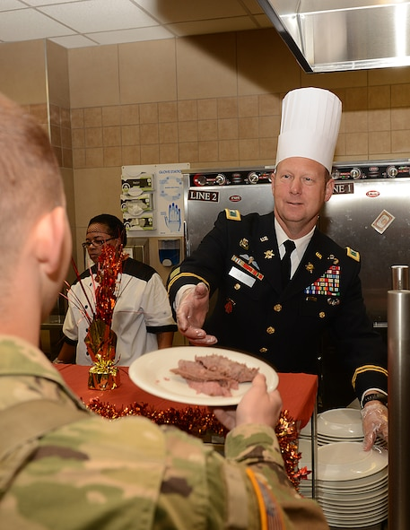 U.S. Army Col. Ralph Clayton III, 733rd Mission Support Group commander, serves Thanksgiving lunch at the Warrior Cafe on Joint Base Langley-Eustis, Va., Nov. 23, 2017.