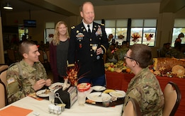 U.S. Army Col. Ralph Clayton III, 733rd Mission Support Group commander, and his daughter Christina, socialize with U.S. Army Soldiers during Thanksgiving lunch at the Warrior Cafe on Joint Base Langley-Eustis, Va., Nov. 23, 2017.