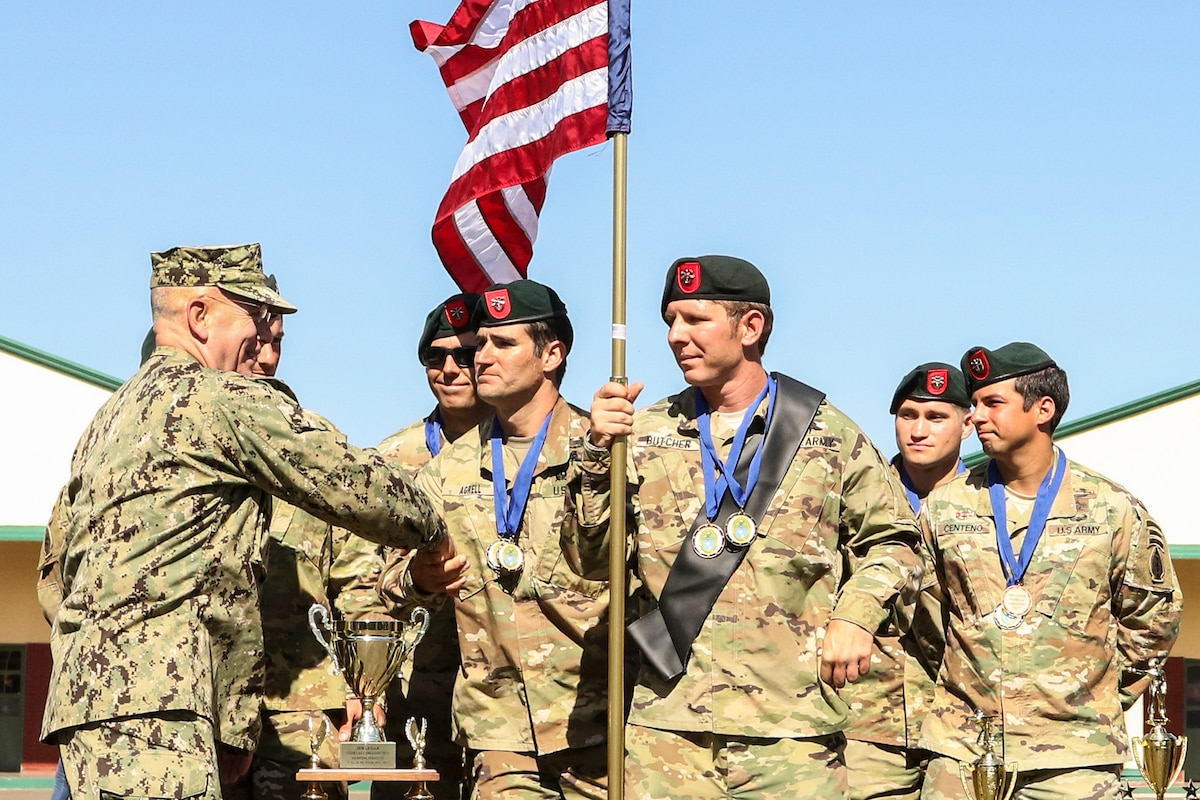 The commander of U.S. Southern Command shakes hands with soldiers.