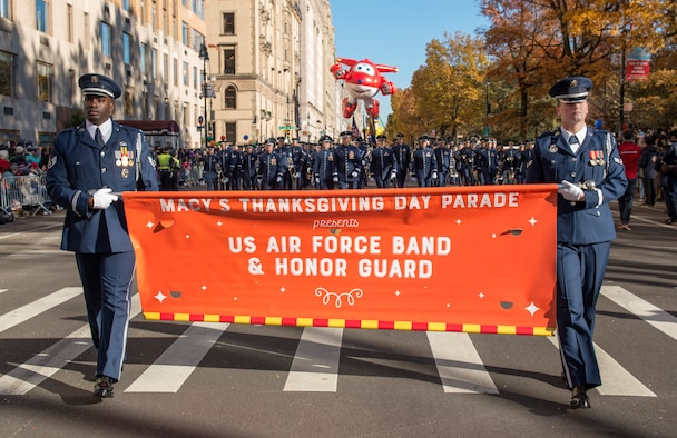 Honor Guardsmen hold banner