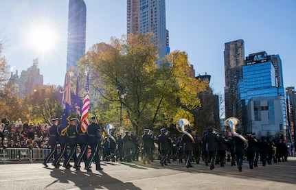 Band and Honor Guard march in parade
