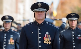 Col. Lang marches in parade