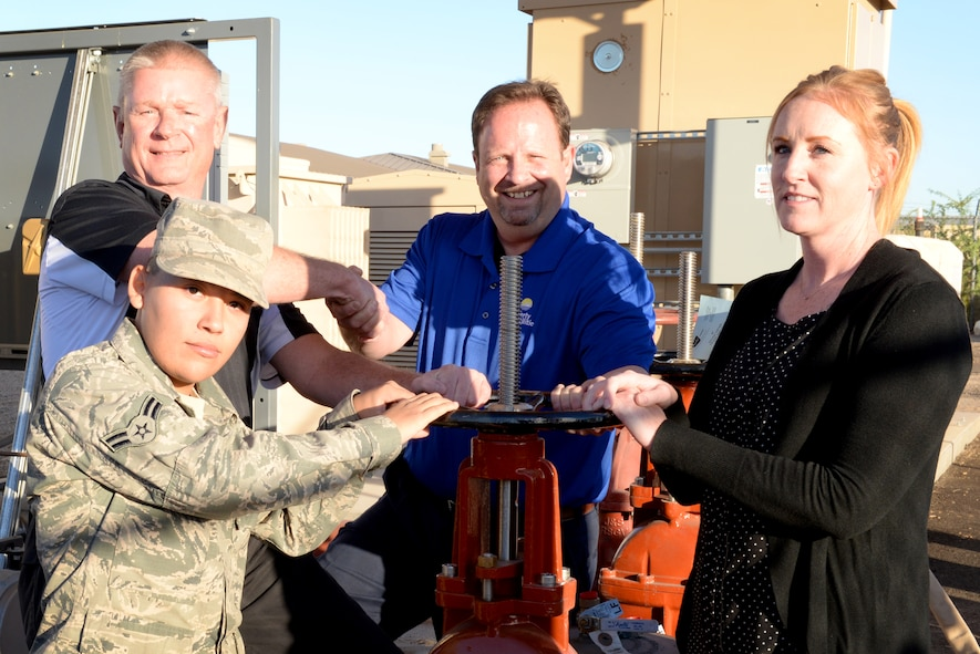 Partnership members from the 56th Civil Engineer Squadron, the 56th Contracting Squadron and Liberty Utilities celebrate the opening of a new water pump at Luke Air Force Base Ariz., Nov. 27, 2017. The new pump will provide the installation with water from off-base until a new water well is created on-base. (U.S. Air Force photo/Senior Airman Ridge Shan)