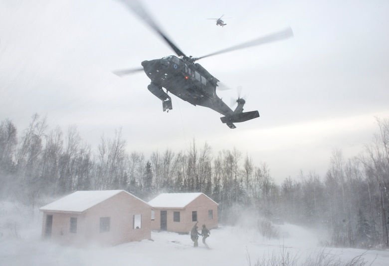 Alaska Air National Guardsmen with the 212th Rescue Squadron and Alaska Army National Guardsmen with the 1st Battalion, 207th Aviation Regiment, participate in a mass-casualty training event at Joint Base Elmendorf-Richardson, Alaska, Nov. 21, 2017.