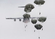 Paratroopers assigned to the 4th Infantry Brigade Combat Team (Airborne), 25th Infantry Division, U.S. Army Alaska, descend after jumping from a C-17 Globemaster III out of Joint Base Charleston, while conducting airborne training over Malemute drop zone, Joint Base Elmendorf-Richardson, Alaska, Aug. 24, 2017.