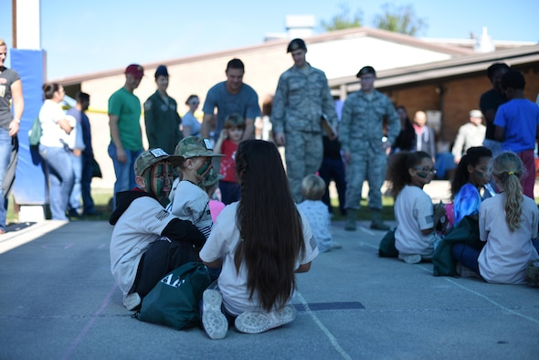 Children participating in the junior deployment at Laughlin Air Force Base, Texas, Nov. 18, 2017, sit under a pavilion at the youth center after a four-hour morning exploring the base and learning the Laughlin mission. The junior deployment is held so military children are better able to understand what their military parent does on a day-to-day basis. (U.S. Air Force photo/Airman 1st Class Anne McCready)