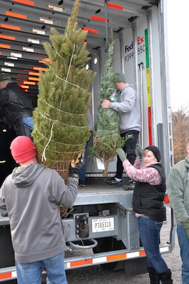 New York Guard helps load Christmas Trees for military families
