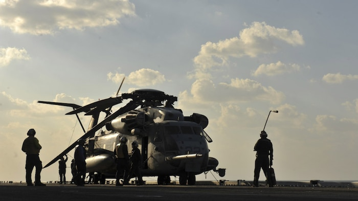 A CH-53E Super Stallion assigned to Marine Medium Tiltrotor Squadron 161 with the 15th Marine Expeditionary Unit sits on the flightdeck of amphibious assault ship USS America.
