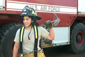 U.S Air Force Staff. Sgt. Alejandra Cepeda, a fire fighter with the 106th Civil Engineer Squadron of the 106th Rescue Wing assigned to the New York Air National Guard, poses with a halligan bar at the 106th Rescue Wing in Westhampton Beach, New York November 2, 2017.