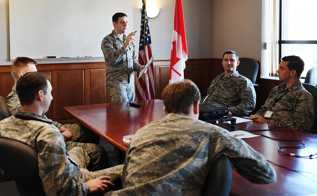 1st Lt. Paul Stocklin leads a briefing.