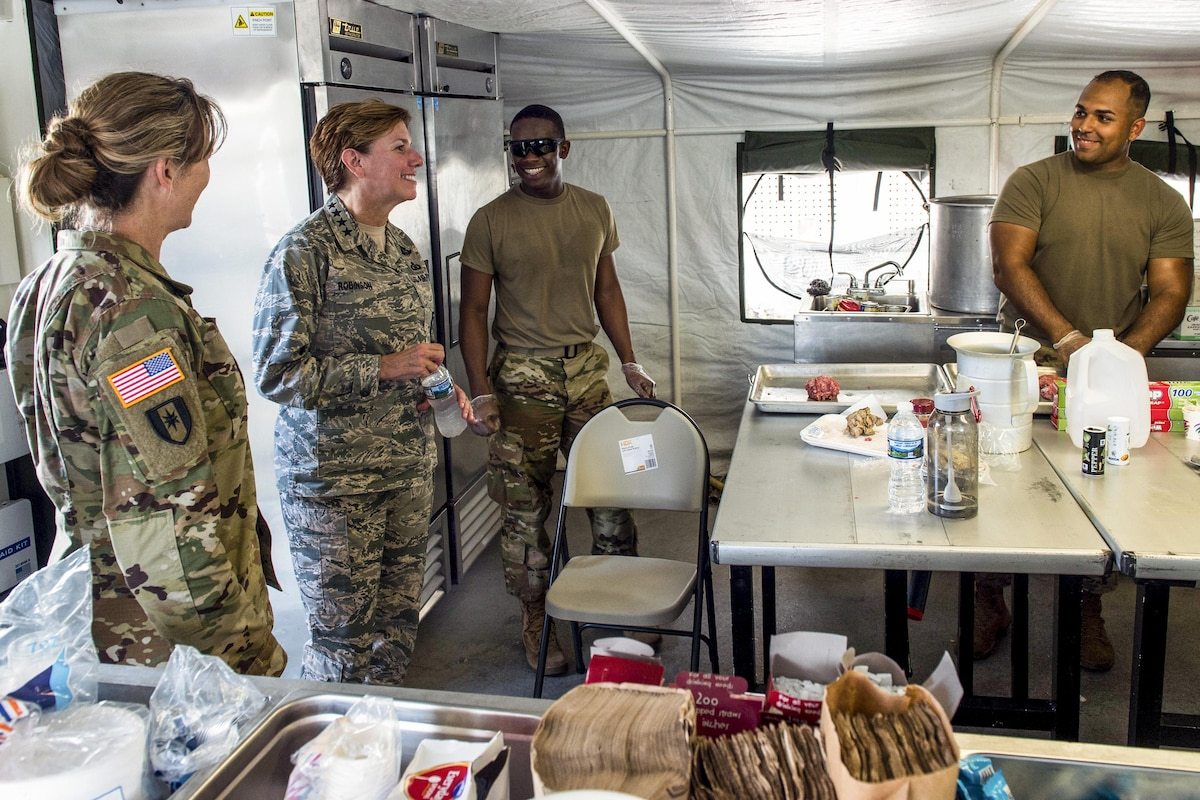 The commander of U.S. Northern Command and North American Aerospace Defense Command receives a tour of a combat hospital.