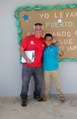 USACE infrastructure assessment inspection team leader James Scungio, left, with Angel Emanuel Martinez Mateo, a student at the Benigna L. Caratini School.