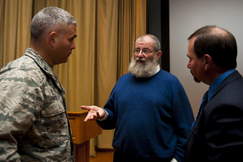 U.S. Air Force Col. Alejandro Ganster, 17th Training Group commander, talks with Dr. Yahya Michot, Hartford Seminary professor, and Anthony Celso, Angelo State University professor of security studies, after a panel discussion on ISIS at the Base Theater on Goodfellow Air Force Base, Texas, Nov. 20, 2017. Michot and Celso gave separate lectures on Islamic extremism, specifically the Islamic State of Iraq and the Levant, and then sat together and answered questions from the audience. (U.S. Air Force photo by Senior Airman Scott Jackson/Released)