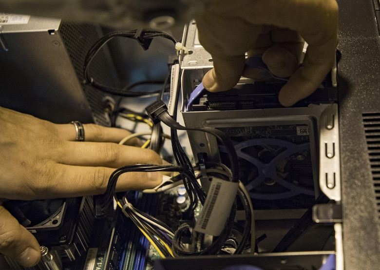 U.S. Air Force Senior Airman Joseph Craft, a Client Systems Technician with the 130th Communications Flight, pulls a hard drive out of a computer Nov. 28, 2017 at McLaughlin Air National Guard Base, Charleston, W.Va. The 130th CF has donated more than 50 devices, with 150 more in the process of preparation to the SecondLaunch Program. (U.S. Air National Guard photo by Airman Caleb Vance)