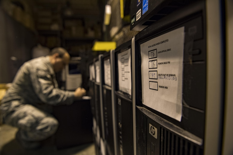 U.S. Air Force Tech. Sgt. James Providenti, 130th Communications Flight Supervisor, puts a computer back together and prepares it for shipping to the SecondLaunch Program Nov. 28, 2017 at McLaughlin Air National Guard Base, Charleston, W.Va.