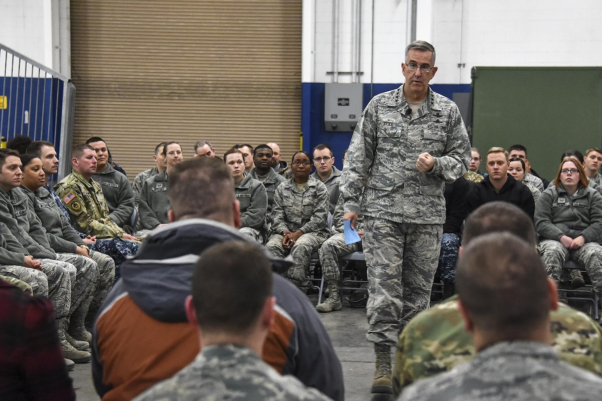 The commander of U.S. Strategic Command speaks with civilians and service members.