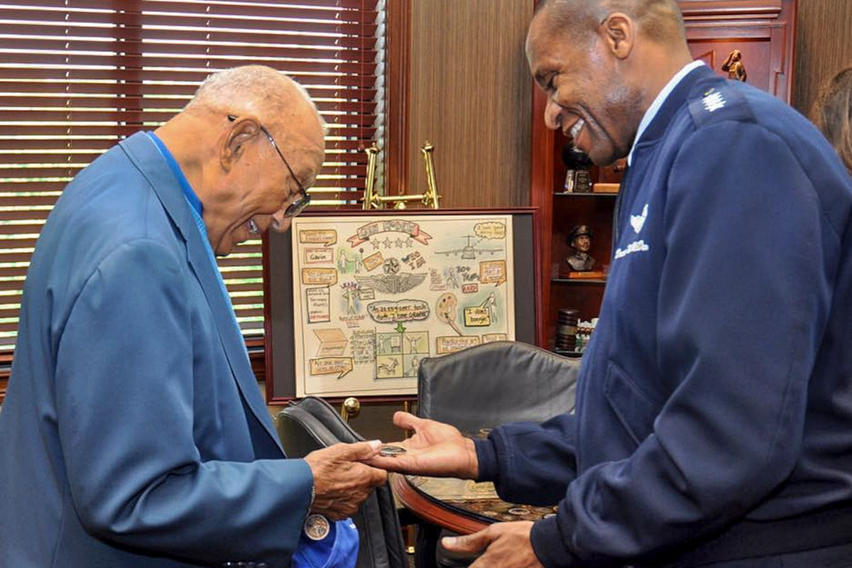 The commander of the U.S. Transportation Command meets with the oldest living Tuskegee airman.