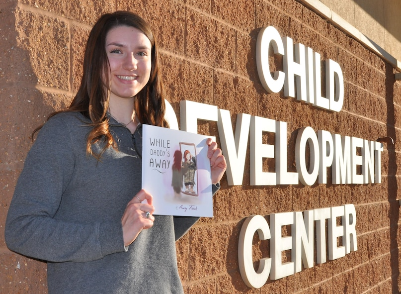 Avery Tibbets, daughter of Brig. Gen. Paul W. Tibbets IV, deputy commander, Air Force Global Strike Command, poses with a book she authored for military children.