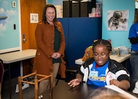 Congresswoman Martha Roby, U.S. Representative for Alabama's Second Congressional District, looks on as a child works on science lessons regarding equal and opposite force during her first visit to STARBASE Maxwell, Nov. 27, 2017, Maxwell Air Force Base, Ala. STARBASE is a Department of Defense educational awareness and outreach program focused on providing Science, Technology, Engineering and Math lessons to fifth graders. During her visit, Roby toured the facility and experience everything the program offers to the local students. (U.S. Air Force photo by Melanie Rodgers Cox/Released.)