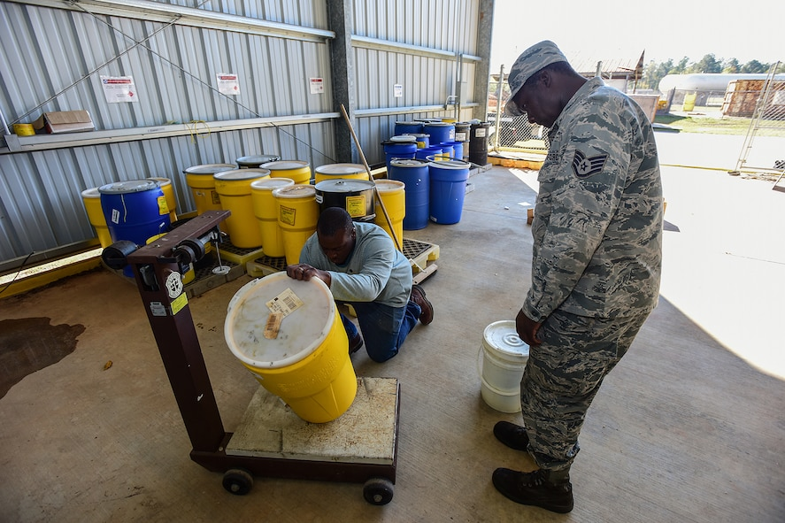 U.S. Air Force Staff Sgt. Christopher Hunter, a crew chief assigned to the 169th Aircraft Maintenance Squadron, drops off materials for disposal at the Central Acquisition Point drop-off center at McEntire Joint National Guard Base, S.C., Nov. 16, 2017. This is one of the programs that the 169th Fighter Wing at McEntire offers in order to assist in keeping the community clean by recycling excess materials. (U.S. Air National Guard photo by Senior Airman Megan Floyd)