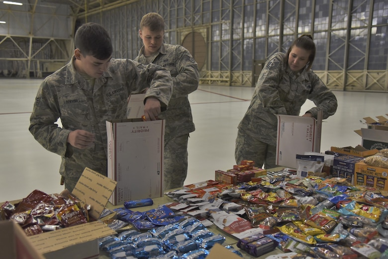 Team Fairchild volunteers pack Treats 2 Troops care packages with donated snacks Nov. 29, 2017, at Fairchild Air Force Base, Washington. KREM 2 News partnered with Team Fairchild for the seventh year in a row to fill care packages with small treats and gifts to help benefit military members serving overseas during the holiday season. (U.S. Air Force photo/Senior Airman Mackenzie Richardson)
