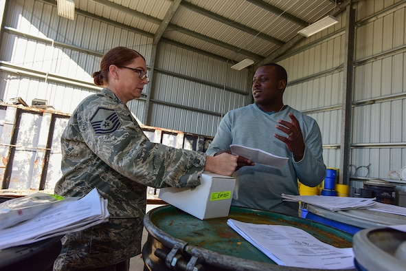 U.S. Air Force Master Sgt. Tabitha Little, a hazmart pharmacy technician assigned to the 169th Logistics Readiness Squadron, drops off materials for disposal at the Central Acquisition Point drop-off center at McEntire Joint National Guard Base, S.C., Nov. 16, 2017. This is one of the programs that the 169th Fighter Wing at McEntire offers in order to assist in keeping the community clean by recycling excess materials. (U.S. Air National Guard photo by Senior Airman Megan Floyd)