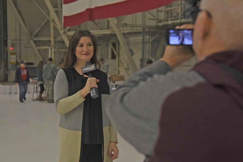 Laura Papetti, KREM 2 News anchor, does a live broadcast of the Treats 2 Troops effort Nov. 29, 2017, at Fairchild Air Force Base, Washington. Treats 2 Troops contributions are not only distributed to Air Force members from Fairchild; our sister services, including the Army, Navy and Marines, also receive packages from the Inland Northwest community.  (U.S. Air Force photo/Senior Airman Mackenzie Richardson)