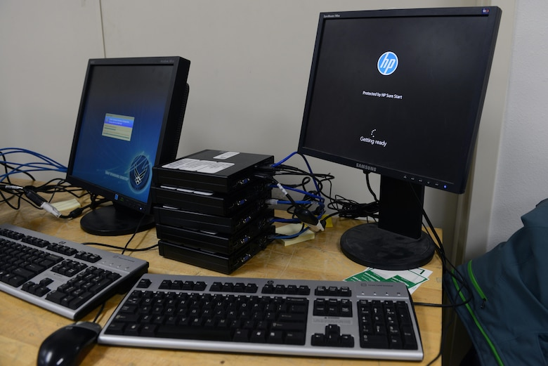 Two computers receive an updated version of Windows 10 with all of the necessary Air Force software in less than four hours at the 673d Communication Squadron building at Joint Base Elmendorf-Richardson, Alaska, Nov. 20, 2017. The 673d CS started this process by manually imaging six computers at a time taking four or more hours, but has since reduced the time and increased the quantity to up to 48 computers.