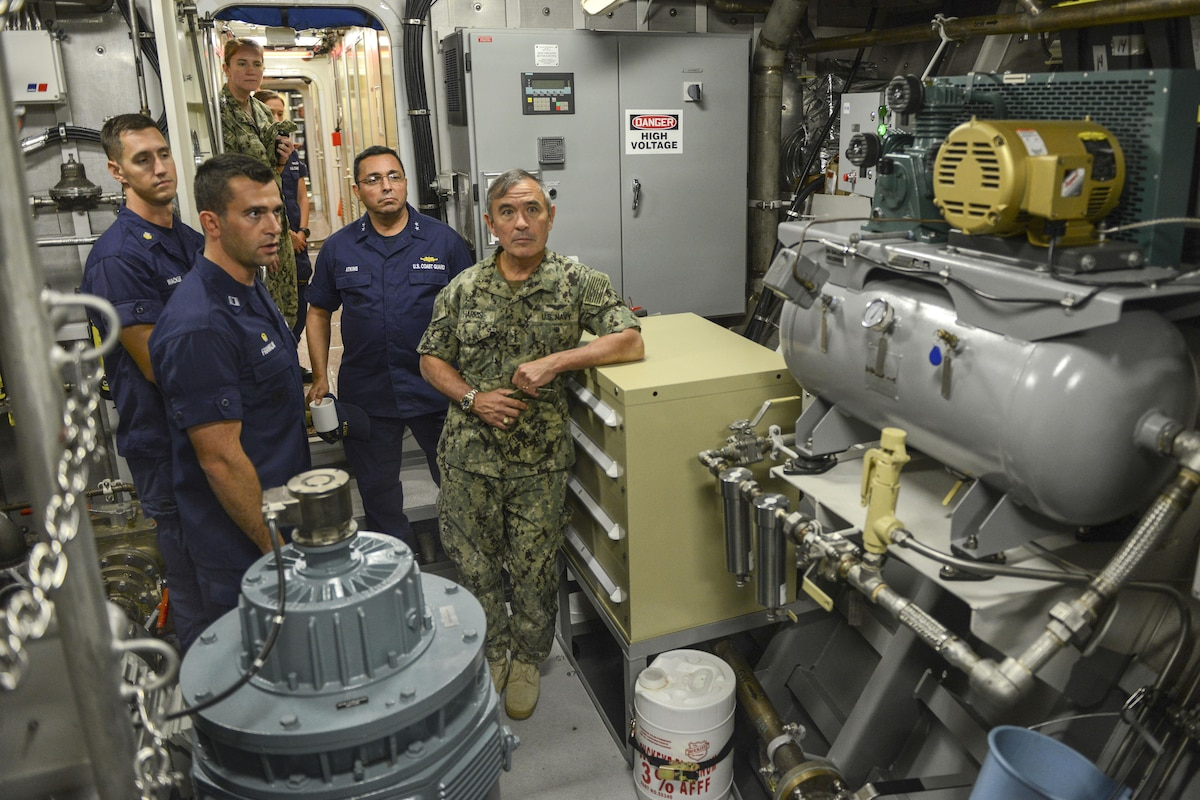 The commander of U.S. Pacific Command visits an engine room on a new cutter.