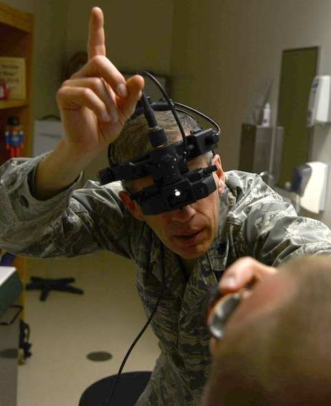 Dr. (Lt. Col.) Richard Baird, an optometrist with the 412th Medical Group, examines a patients eyes. Baird was recently selected as both the Air Force Optometrist of the Year as well as the Armed Forces Optometrist of the Year. (U.S. Air Force photo by Christopher Ball)