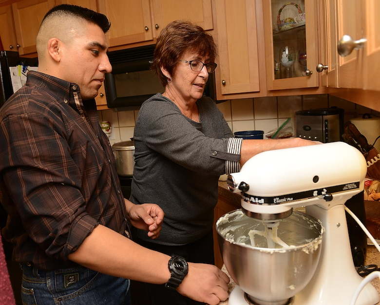 U.S. Army Spc. Efrain Luna, 128th Aviation Brigade Advanced Individual Training student, helps Janice Deaver at her home in Yorktown, Va., Nov. 23, 2017.