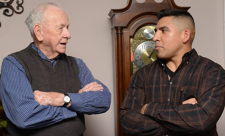 Mark Flockhart, U.S. Air Force Hospital Langley volunteer, and U.S. Army Spc. Efrain Luna, 128th Aviation Brigade Advanced Individual Training student, discuss military culture in Yorktown, Va., Nov. 23, 2017.