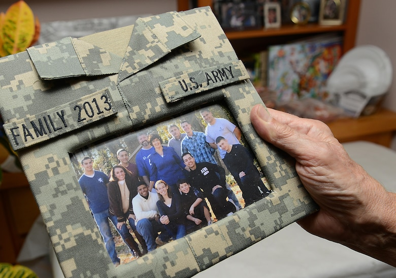 Janice Griffin holds a framed photo of her family and U.S. Army Soldiers at her home in Yorktown, Va., Nov. 23, 2017.