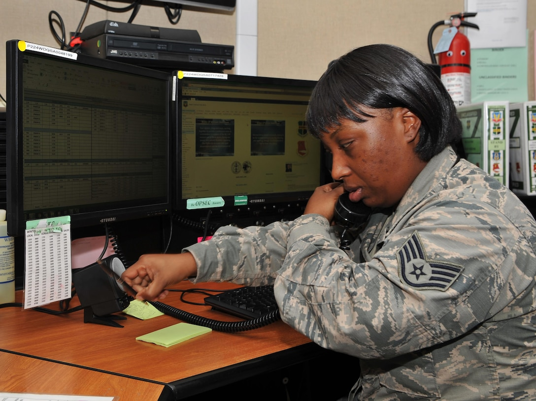 Staff Sgt. Courtney Jackson, 9th Reconnaissance Wing Beale command post senior emergency action controller answers a phone call