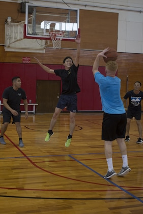 CAMP KINSER, OKINAWA, Japan— A member of the Japan Ground Self-Defense Force jumps to block a shot during a basketball game Nov. 27 aboard Camp Kinser, Okinawa, Japan.