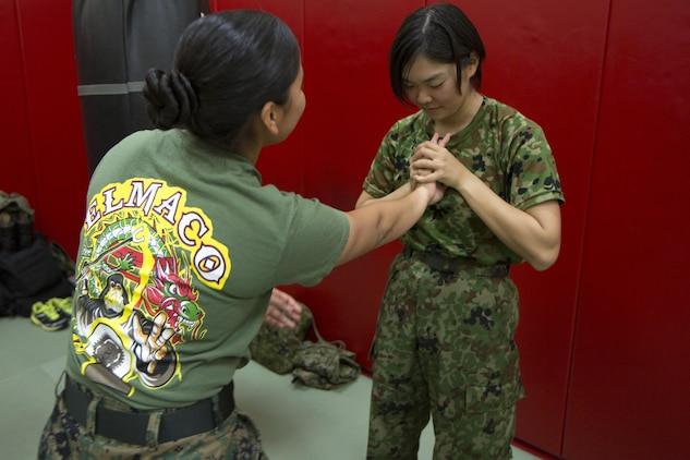CAMP KINSER, OKINAWA, Japan—Leading Pvt. Abe Seira performs reverse wrist lock during a Marine Corps Martial Arts Program demonstration during a culture exchange Nov. 27 aboard Camp Kinser, Okinawa, Japan.