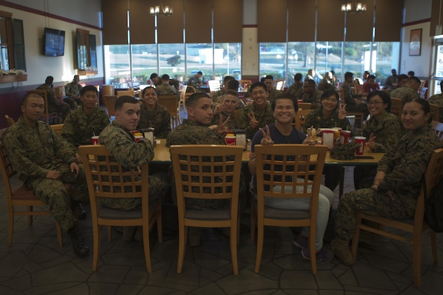 CAMP KINSER, OKINAWA, Japan— A group poses for a photo at dinner at Surfside Nov. 27 aboard Camp Kinser, Okinawa, Japan.