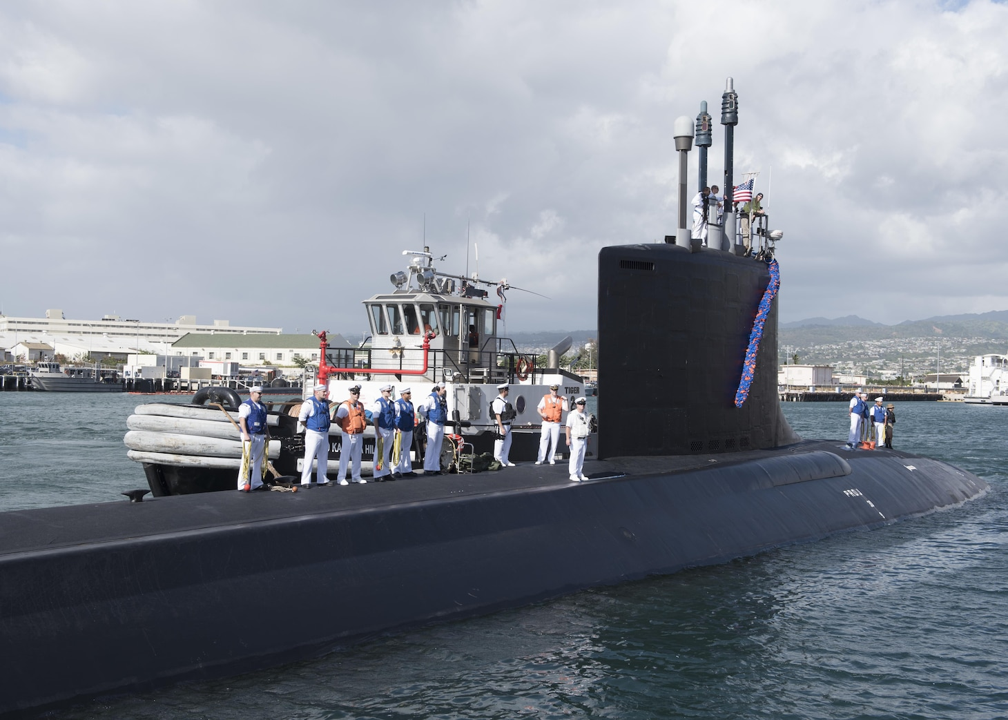 Virginia-class attack submarine USS Illinois (SSN 786) arrives at Joint Base Pearl Harbor-Hickam, after completing a change of homeport from Groton, Connecticut, Nov. 22.  (U.S. Navy Photo by Mass Communication Specialist 2nd Class Shaun Griffin/Released)