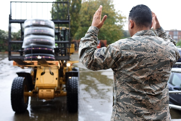 An Airman assigned to the 48th Logistics Readiness Squadron marshals in a forklift at Royal Air Force Lakenheath, England, Oct. 18. The ground transportation element of the 48th LRS is responsible for transporting parts, equipment and Airmen anywhere they are needed. (U.S. Air Force photo/Airman 1st Class Eli Chevalier)