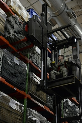 Staff Sgt. Timothy Snyder, 436th Logistics Readiness Squadron materiel management supervisor, retrieves a crate of gas masks from storage during a Civil Reserve Air Fleet readiness exercise Nov. 13, 2017, inside the individual protective equipment warehouse on Dover Air Force Base, Del. The IPE was packed and prepared for transportation as part of the first Civil Reserve Air Fleet IPE transportation exercise. (U.S. Air Force photo by Staff Sgt. Aaron J. Jenne)