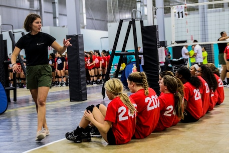 Sergeant Katherine Bynum, a canvassing recruiter with Recruiting Substation Yulee, Recruiting Station Jacksonville, 6th Marine Corps District, leads local athletes in warm-up exercises before the USMC Sports Leadership Academy in Jacksonville, Florida, on Nov. 19, 2017. The leadership academy is designed to teach athletes the fundamentals of Marine Corps leadership while learning techniques and skillsets for a particular sport. (U.S. Marine Corps Photo by Sgt. Tony Simmons)