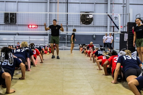Sergeant Benjamin Blevins, a canvassing recruiter with Recruiting Substation Yulee, Recruiting Station Jacksonville, 6th Marine Corps District, leads local athletes in warm-up exercises before the USMC Sports Leadership Academy in Jacksonville, Florida, on Nov. 19, 2017. The leadership academy is designed to teach athletes the fundamentals of Marine Corps leadership while learning techniques and skillsets for a particular sport. (U.S. Marine Corps Photo by Sgt. Tony Simmons)