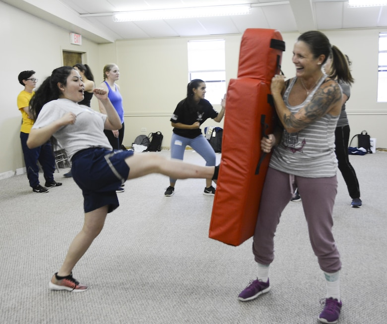U.S. Air Force Airman Lesley Serrano, 316th Training Squadron trainee, practices kicking drills with Theresa Goodwin, 17th Training Wing school liaison officer, during the Rape Aggression Defense class held at the Goodfellow Resilience Center, Goodfellow Air Force Base, Oct. 29, 2017. In addition to nine hours of instruction time, the RAD class included three hours of aggressor simulations.