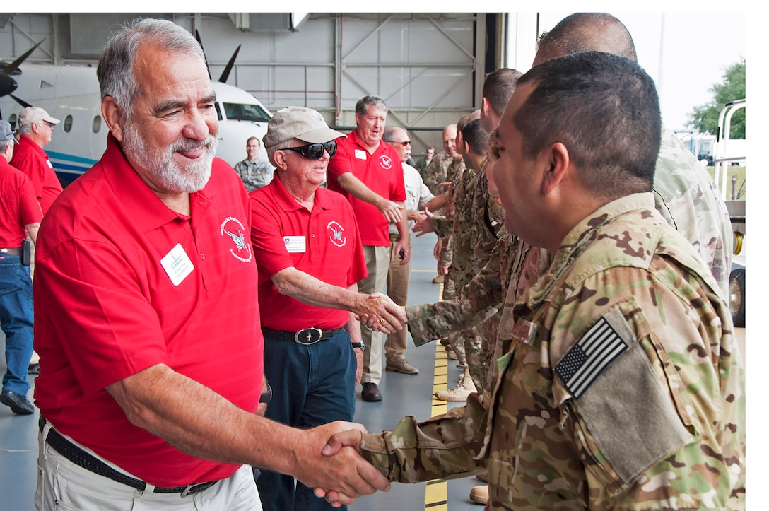 Members of the Air Commando Association's board of directors meet Reserve and active-duty combat aviation advisors