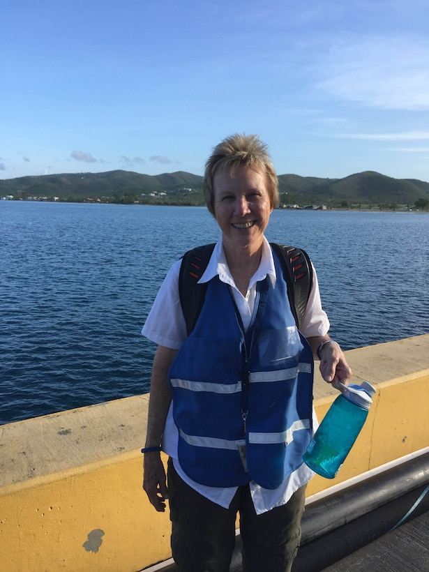 Claudette Wells, an acquisition program manager for the Air Force Technical Applications Center, Patrick AFB, Fla., stands near the dock at Frederiksted, St. Croix as she prepares to head out to work as a Federal Emergency Management Agency disaster relief volunteer.  Wells was part of FEMA's Surge Capacity Force that helped those affected by Hurricane Maria, a Category 5 storm that barreled through the Caribbean in September 2017.  (Courtesy photo)