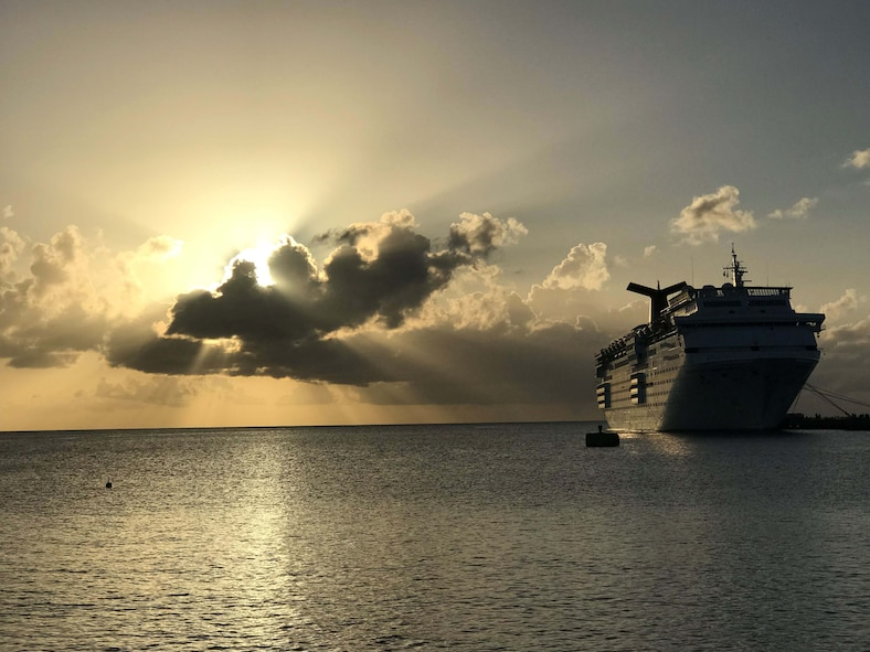 The sun slowly rises over the Lesser Antilles as Carnival Cruise Lines' ship, Fascination, can be seen moored at Frederiksted, St. Croix.  The docked ship was used to feed and house Federal Emergency Management Agency personnel who volunteered to help with disaster relief efforts after Hurricane Maria impacted the region in October 2017.  (U.S. Air Force photo by M. Claudette Wells)