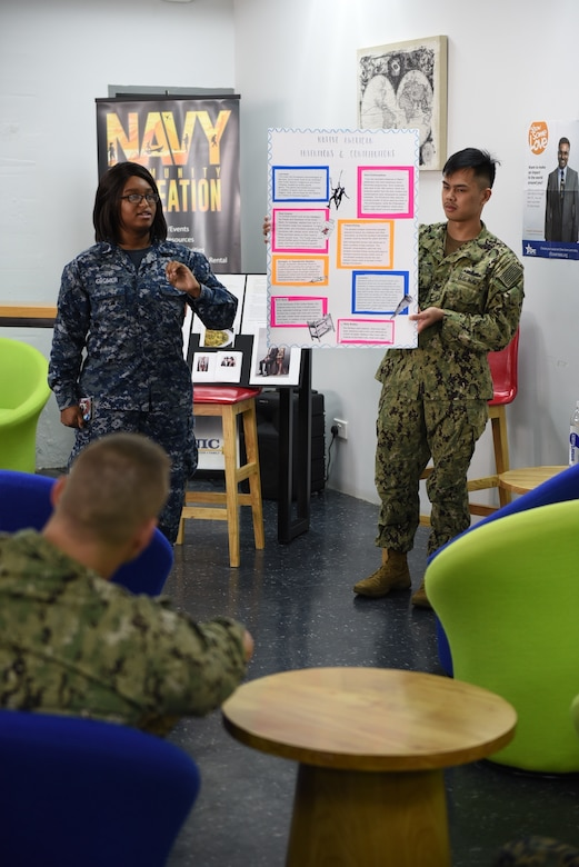 Sailors describe some Native American inventions still used widely today during a Native American Heritage Month celebration at the Singapore area coordinator's Cafe Lah Community Center, Nov. 16, 2017. Service members highlighted the achievements and contributions of Native Americans and Alaska Natives to the United States and the American military experience. Navy photo by Marc Ayalin