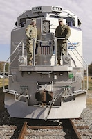 Fort Riley garrison commander Col. John D. Lawrence, left, and Maj. Gen. Lee Tafanelli, adjutant general of Kansas National Guard and director of Emergency Management and Homeland Security, pose at the front of Locomotive No. 1943, The Spirit, during Union Pacific Salute to the Military Nov. 6 near the First Territorial Capitol building.