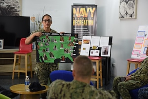 A service member teaches other service members about Native American heritage.
