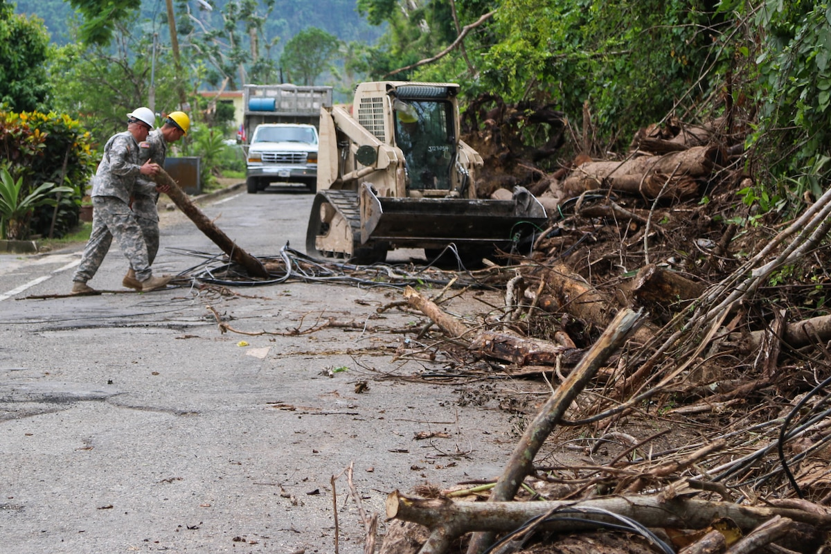 Guard help clear roads in Puerto Rico.